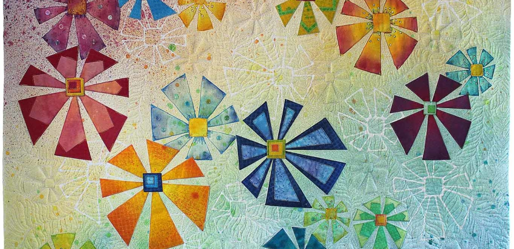 Geometric Flowers Quilt in Pastel Rainbow_edit