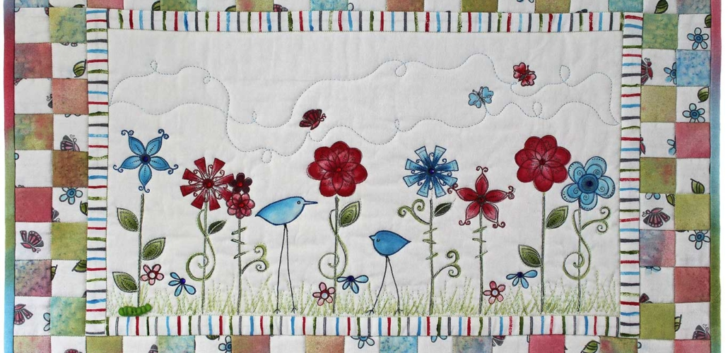 Red and Blue Whimsical Flowers and Birds Rectangular Quilt_edit